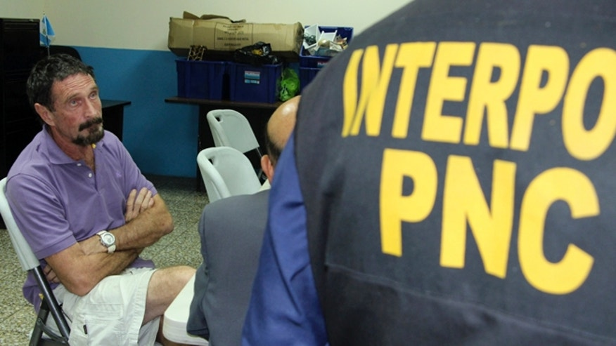 Dec. 5, 2012: Software company founder John McAfee sits after being arrested for entering Guatemala illegally. The anti-virus guru was detained at a hotel in an upscale Guatemala City neighborhood with the help of Interpol agents hours after he said he would seek asylum in the Central American country.