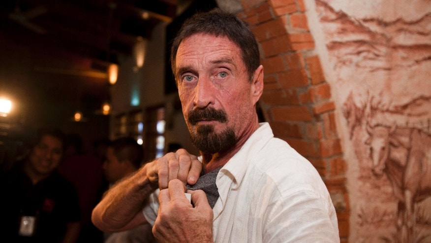 Dec. 4, 2012: Software company founder John McAfee adjusts a microphone in preparation for an interview in Guatemala City. The anti-virus company founder fled Belize and is seeking political asylum in Guatemala, according to his lawyer Telesforo Guerra.