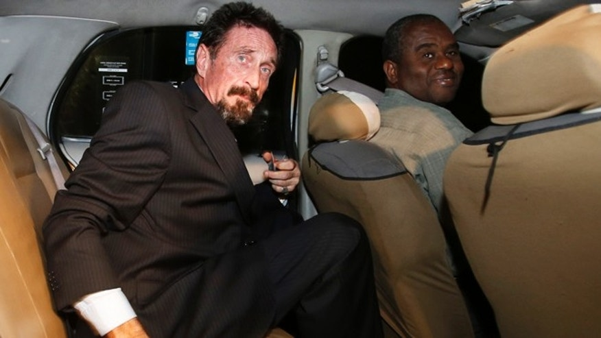 Dec 12, 2012: Anti-virus software founder John McAfee sits in a taxi cab in the South Beach area of Miami Beach, Fla., on his way to dinner. McAfee arrived in the U.S. on Wednesday night after being deported from Guatemala.