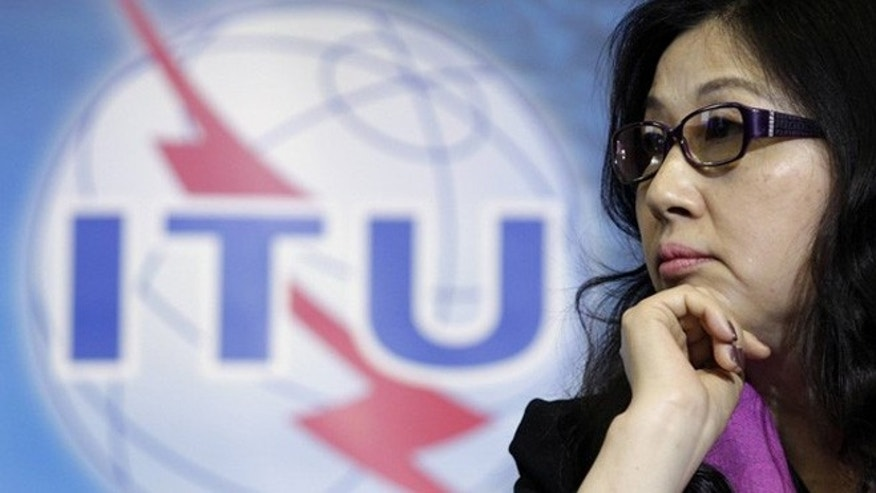 May 16, 2012: Sun Yafang, chairwoman of the board of Huawei Technologies listens to a speech before receiving a World Telecommunication and Information Society Award at the International Telecommunication Union (ITU) headquarters in Geneva.