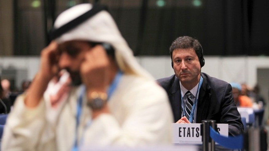 Dec. 14, 2012: Terry Kramer, head of the U.S. delegation, right, listens to a speech at the final day of World Conference on International Telecommunications in Dubai, United Arab Emirates.