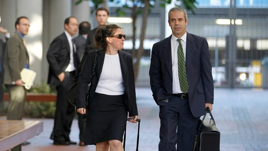 Aug 24, 2012: Kevin Johnson, right, and Victoria Maroulis, left, attorneys for Samsung, leave the US Courthouse and Federal building after a jury reached a decision in the Apple Samsung trial in San Jose, Calif. The jury ordered Samsung to pay Apple $1.05 billion. An appeal is expected.