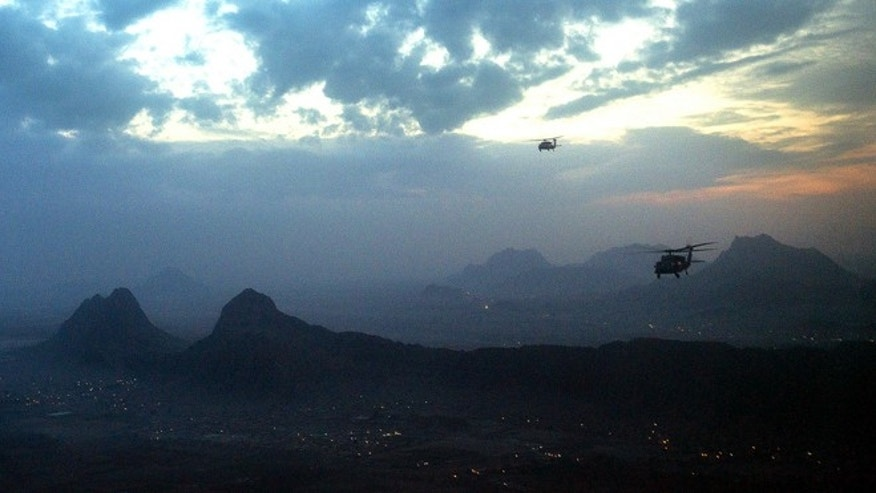 "Dec. 16, 2012: Blackhawk helicopters fly to Kandahar -- an ordinary day, despite widespread fearmongering of an impending ""doomsday."""