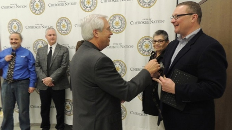 Dec. 19, 2012: Principal Chief Bill John Baker gives Microsoftâs Don Lionetti a tie in the Cherokee syllabary for the companyâs partnership to get Cherokee on Windows 8.