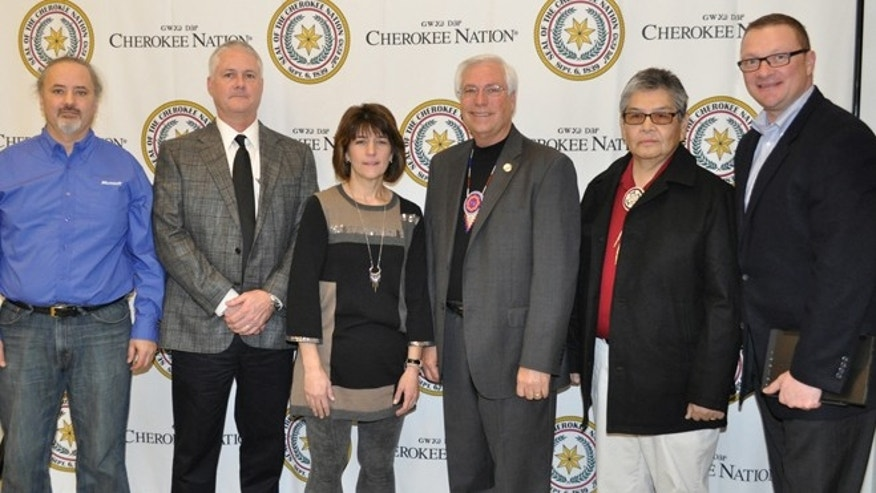 Dec. 19, 2012: Microsoft software engineer Tracy Monteith, Cherokee Nation chief information officer Jon James, Microsoft senior program manager Carla Hurd, Principal Chief Bill John Baker, Cherokee Nation translator Durbin Feeling and Microsoft tribal government account manager Don Lionetti celebrate the launch of Cherokee on Windows 8 in Tahlequah, Okla.