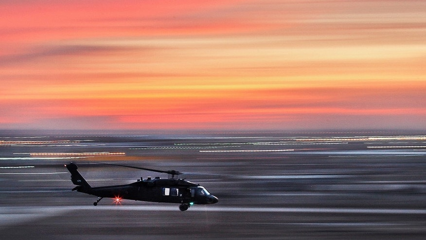 Jan. 11, 2010: A UH-60 Black Hawk helicopter from 1st Air Cavalry Brigade, 1st Cavalry Division, U.S. Division Center, swiftly departs the flight line during dusk.