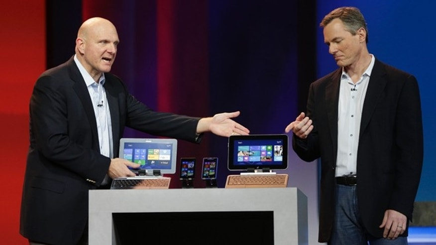 Jan. 7, 2013,: Microsoft CEO Steve Ballmer, left, and Qualcomm CEO Paul Jacobs talk about various Windows based products that utilize Qualcomm technology during Jacobs' keynote address at the Consumer Electronics Show.