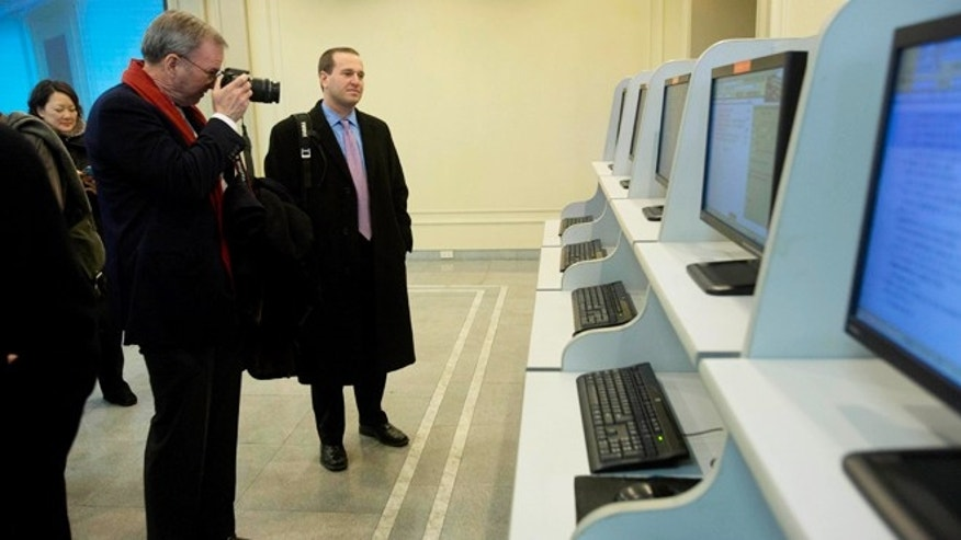 Jan. 8, 2013: Executive Chairman of Google, Eric Schmidt, takes photographs as he tours a computer lab at Kim Il Sung University in Pyongyang, North Korea.