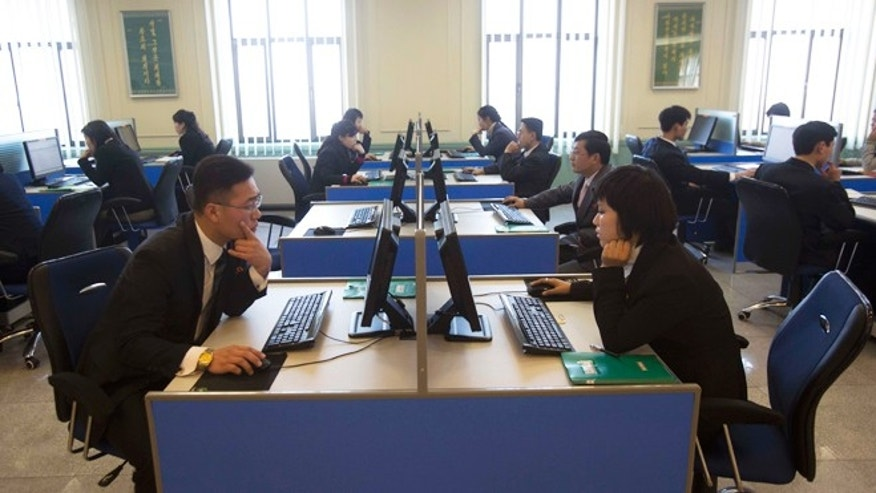 Jan. 8, 2013: North Korean students work at computer terminals inside a computer lab at Kim Il Sung University during a tour by Google's Eric Schmidt.