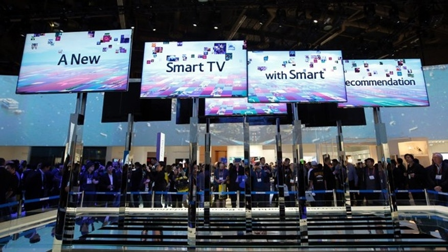 Jan. 8, 2013: Show attendees look at an installation made with smart TVs at the Samsung booth at the International Consumer Electronics Show in Las Vegas.
