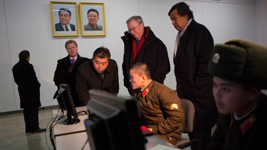 Jan. 9, 2013: Executive Chairman of Google, Eric Schmidt, back row left, and former Governor of New Mexico Bill Richardson, back row right, look at North Korean soldiers working on computers at the Grand Peoples Study House in Pyongyang, North Korea.