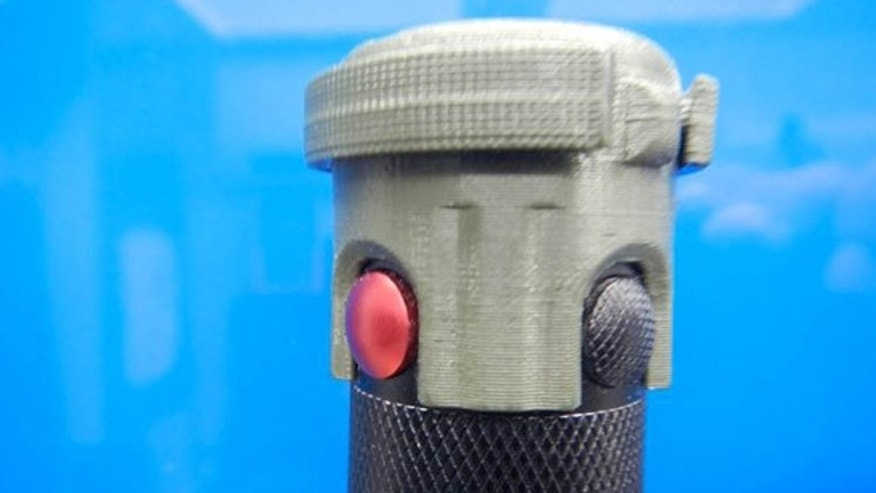 A commonly used Army-issue flashlight has raised, exposed button that allow the light to be accidently turned on in pocket or pouch. This guard was developed and printed to prevent accidental power up and to save batteries.