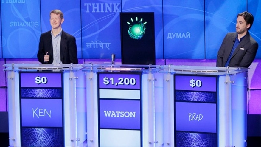 &quot&#x3b;Jeopardy!&quot&#x3b; champions Ken Jennings, left, and Brad Rutter, right, look on as an IBM computer called &quot&#x3b;Watson&quot&#x3b; beats them to the buzzer to answer a question during a practice round of the &quot&#x3b;Jeopardy!&quot&#x3b; quiz show in Yorktown Heights, N.Y., Thursday, Jan. 13, 2011.