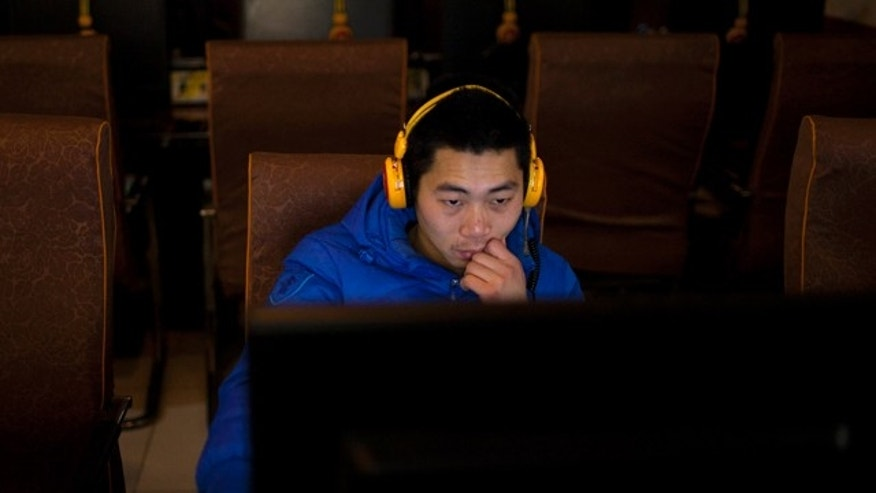 Dec. 28, 2012: A man uses a computer at an internet cafe in central Beijing, China.