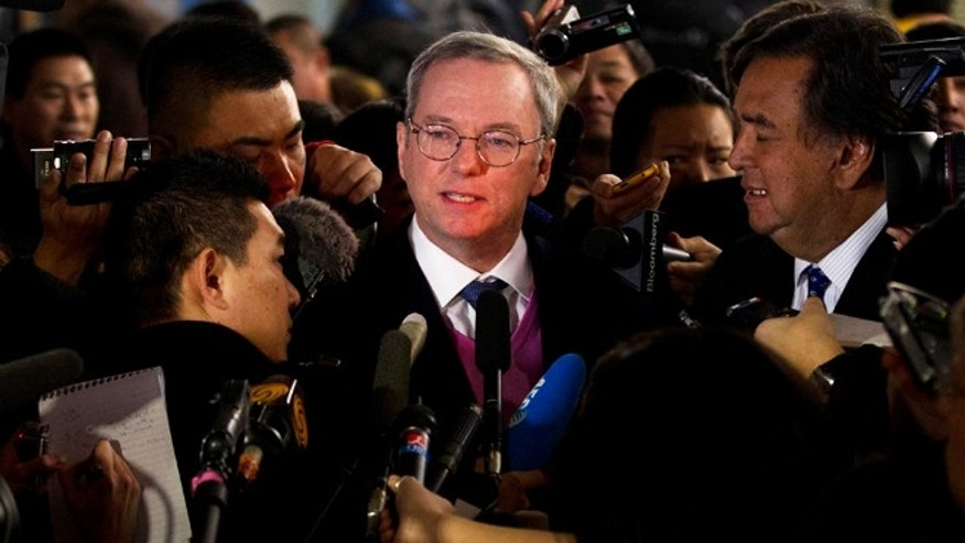 Jan. 10, 2013: Google executive chairman Eric Schmidt, center, and former New Mexico Gov. Bill Richards, right, brief journalists after they arrived at Beijing Capital International Airport from Pyongyang, in Beijing.