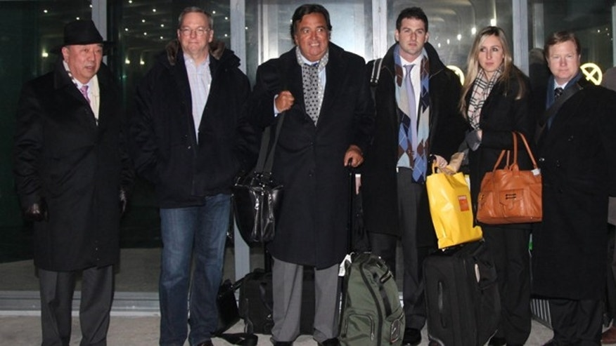 Jan. 7, 2013: Former New Mexico Gov. Bill Richardson, third left, and Google Executive Chairman Eric Schmidt, second left, pose for photos after arriving at an airport in Pyongyang, North Korea.