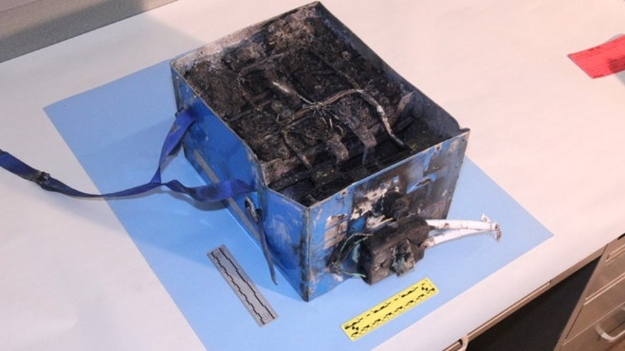This undated photo provided by the National Transportation Safety Board shows the burned auxiliary power unit battery from a JAL Boeing 787 that caught fire on Jan. 7, 2013, at Boston&#39&#x3b;s Logan International Airport.
