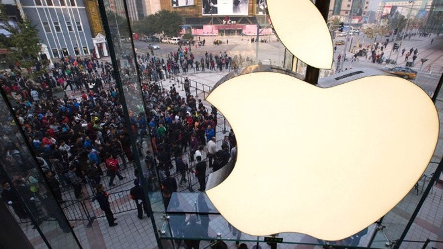 Oct. 20, 2012: People line up to enter a newly-opened Apple Store in Wangfujing shopping district in Beijing.