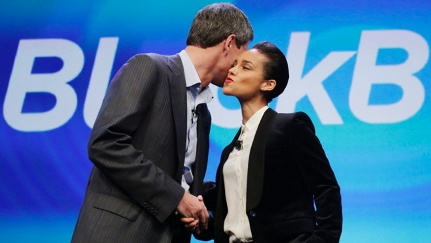 Jan. 30, 2013: Thorsten Heins, CEO of Research in Motion, kisses Alicia Keys as he introduces her as the Global Creative director of Blackberry in New York.