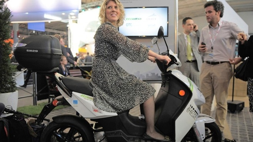 Feb. 26, 2013: A woman sits on an eCooltra Connected electric scooters at Mobile World Congress in Barcelona, Spain.