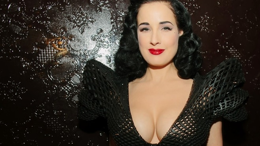 Mar. 4, 2013: Burlesque queen Dita Von Teese models a 3D dress at an event at the Ace Hotel in New York.