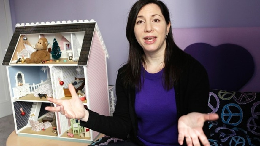 "March 4, 2013: Rebecca Levey, mother of 10-year-old twin girls, poses for a photograph in the girls' bedroom in New York. Levey, who also runs a tween video review site called KidzVuz.com and blogs about technology and educations issues, says, ""What sex education used to be -- it's now the 'technology talk' we have to have with our kids."""