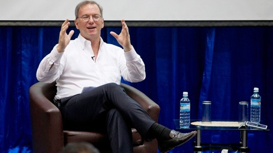 March 22, 2013: Google Executive Chairman Eric Schmidt gestures during  an interactive session with group of students at a technical university in Yangon, Myanmar. Schmidt on Friday urged Myanmar's government to allow private businesses to develop the country's woeful telecommunications infrastructure.