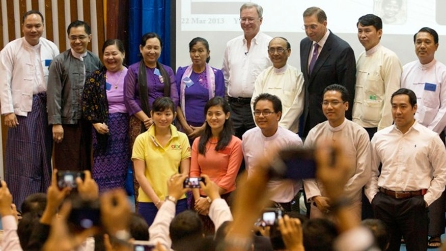 March 22, 2013: Google Executive Chairman Eric Schmidt, center, poses for photos with a group of Myanmar students and entrepreneurs after an interactive session at a technical university in Yangon, Myanmar.