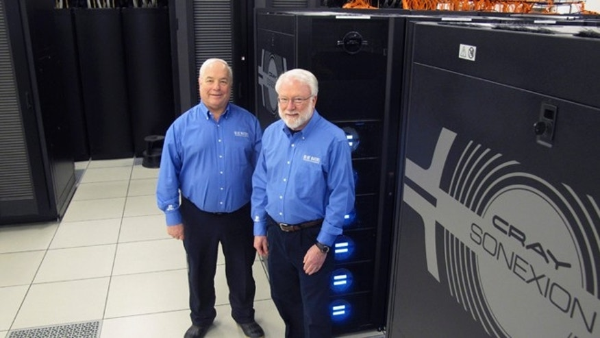 March 25, 2013: Blue Waters project director Bill Kramer, left, and National Center for Supercomputing Applications Director Thom Dunning pose alongside the storage system for the Blue Waters supercomputer at the University of Illinois in Champaign, Ill. The $300 million project was recently completed, less than two years after it looked as if it might not be finished at all.