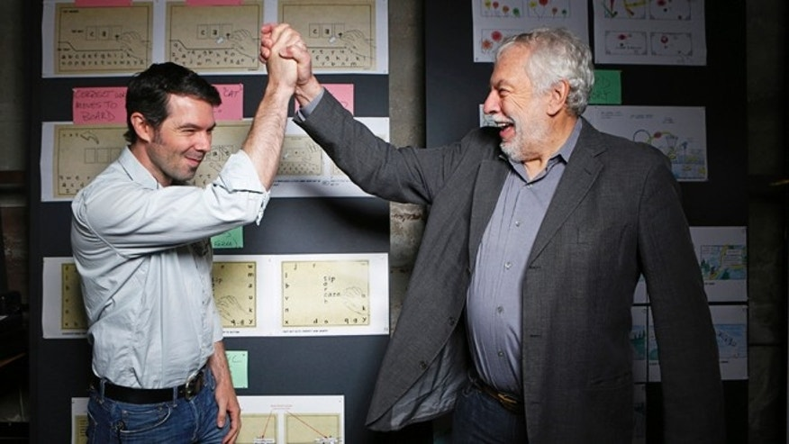 "Mar. 20, 2013: Nolan Bushnell, the founder of Atari, right cheers his son, Brent Bushnell, CEO of ""Two-Bits-Circus,"" a Los Angeles idea factory focused on software, hardware and machines."