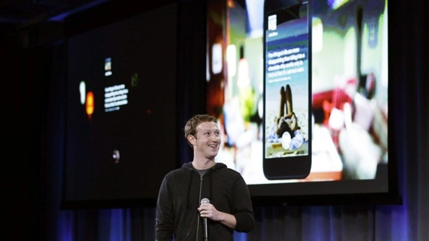 April 4, 2013: Facebook CEO Mark Zuckerberg speaks at the company's headquarters in Menlo Park, Calif. Zuckerberg says the company is not building a phone or an operating system. Rather, Facebook is introducing a new experience for Android phones.