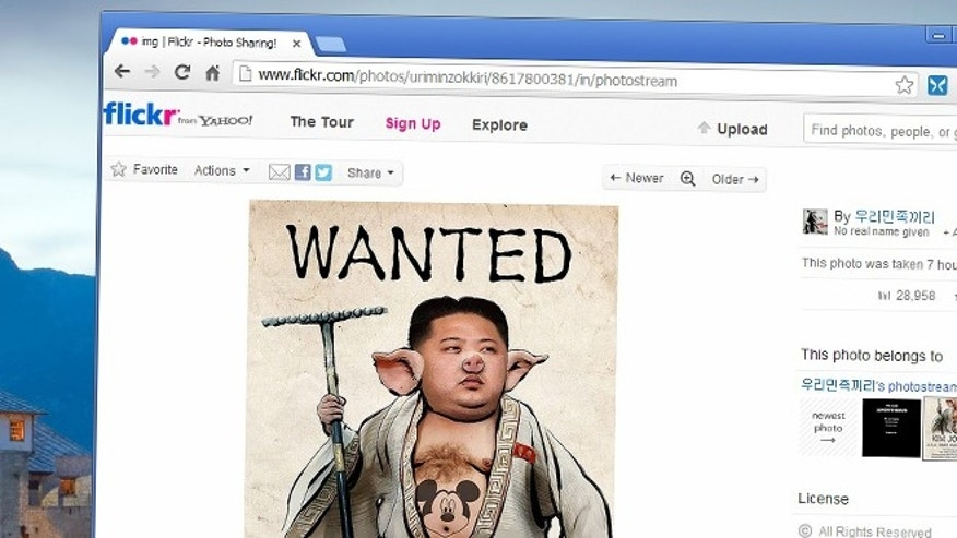 Apr. 4, 2013: A screenshot of an image apparently posted by hackers to North Korea's Flickr page depicts Kim's face with a pig-like snout and a drawing of Mickey Mouse on his chest.