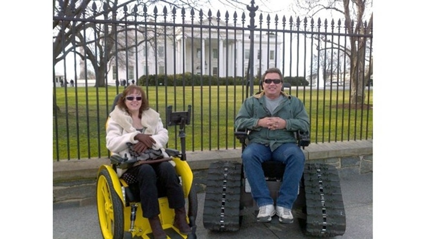 Brad Soden and his wife Liz in front of the White House in a speedster and Tank Chairs which he originally designed to provide more mobility for his wife who was paralyzed in a car accident in 1999.