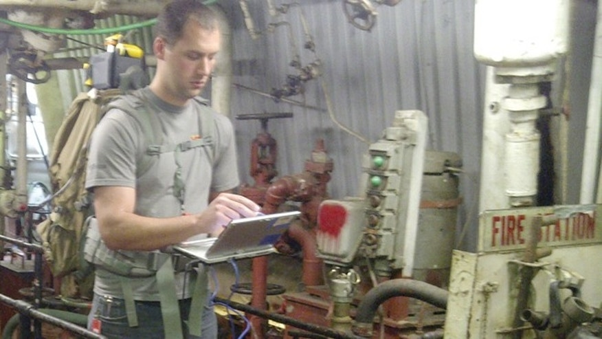An Johns Hopkins engineer uses EMAPS aboard a ship to generate a map.