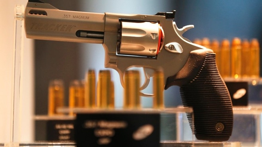 April 9, 2013: A Taurus Tracker .357 magnum gun and bullets are displayed at the Defence and Security International Exhibition Latin America Aero and Defence (LAAD) trade show in Rio de Janeiro.