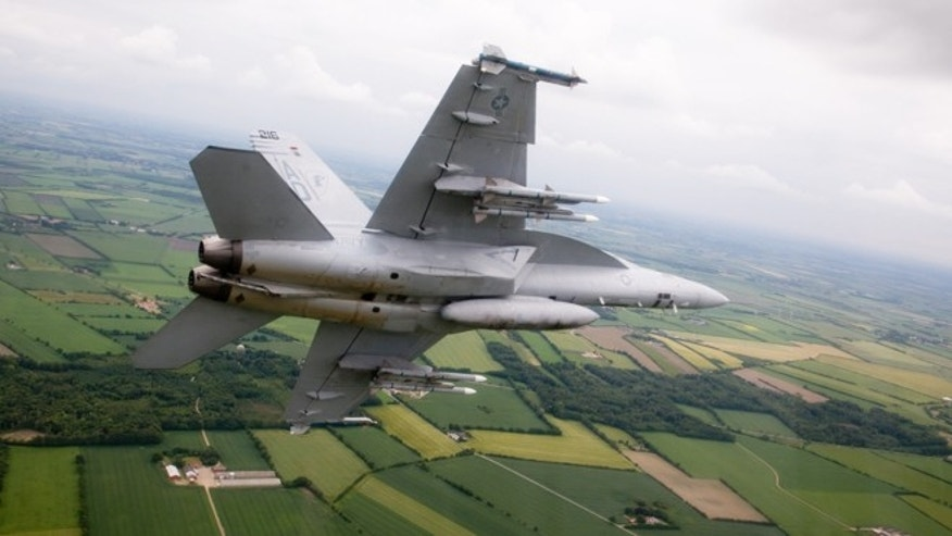 A Boeing Super Hornet in transit to Denmark in 2009, flying with the Royal Danish Air Force.