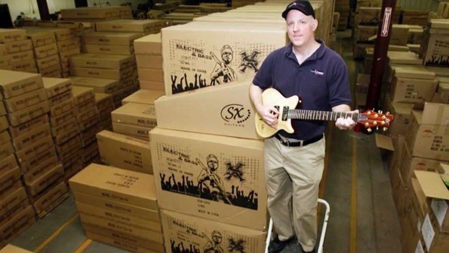 April 30, 2013: Kurt Zentmaier poses in his warehouse full of guitars in Claremont, N.H. Zentmaier is president of Rondo Music which sells its guitars online only and doesn&#39&#x3b;t want an Internet sales tax.
