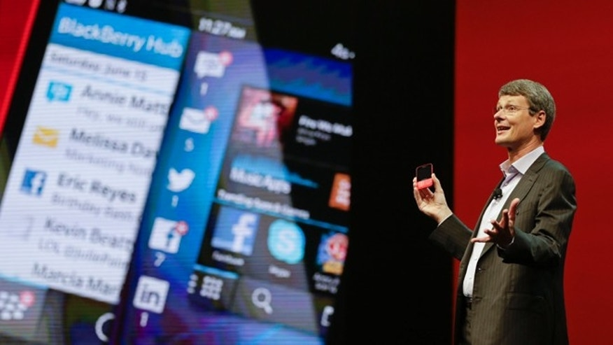 May 14, 2013: Thorsten Heins, president and CEO at BlackBerry holds up the new BlackBerry 10 mobile device at a conference in Orlando, Fla.