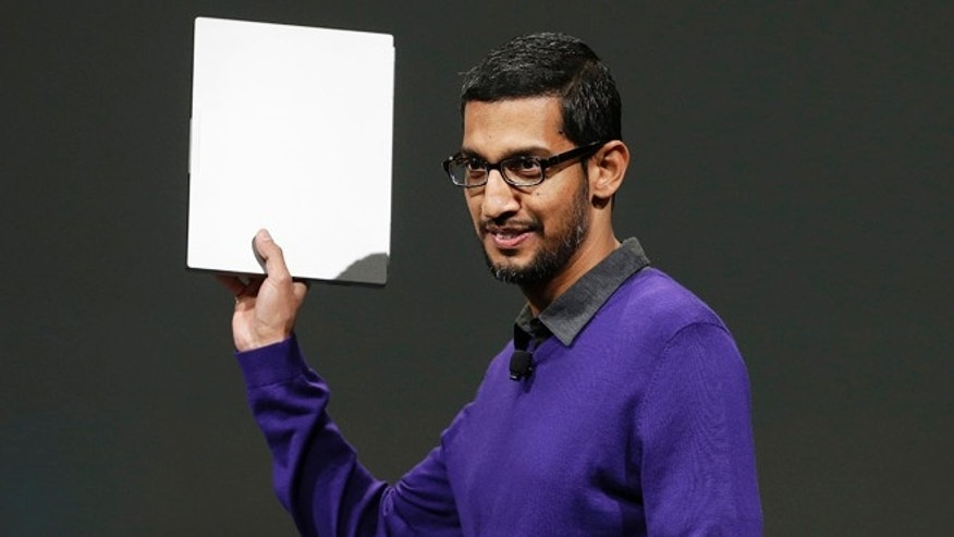 May 15, 2013: Sundar Pichai, senior vice president, Chrome and Apps at Google, holds a Google Chromebook Pixel laptop computer at Google I/O 2013 in San Francisco.
