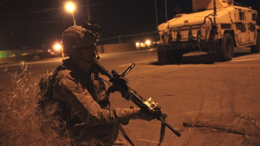 May 13, 2013: Capt. Matthew McCue, platoon commander the 13th Marine Expeditionary Unit and San Diego native, coordinates security from a blocking position during a training raid in Brawley, Calif., as part of Ground Realistic Urban Training.