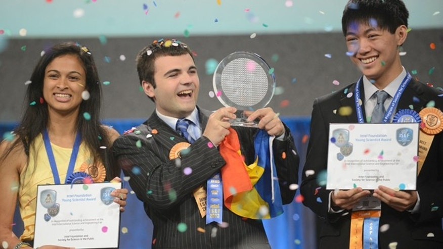 May 17, 2013: Top winner Ionut Budisteanu, 19, of Romania (center) with second-place winners Eesha Khare, 18, of Saratoga, Calif. (left) and Henry Lin, 17, of Shreveport, La. celebrate their awards at the Intel International Science and Engineering Fair, the world's largest high school science research competition. More than 1,600 high schoolers from 70 countries, regions and territories competed for more than $4 million in awards this week.