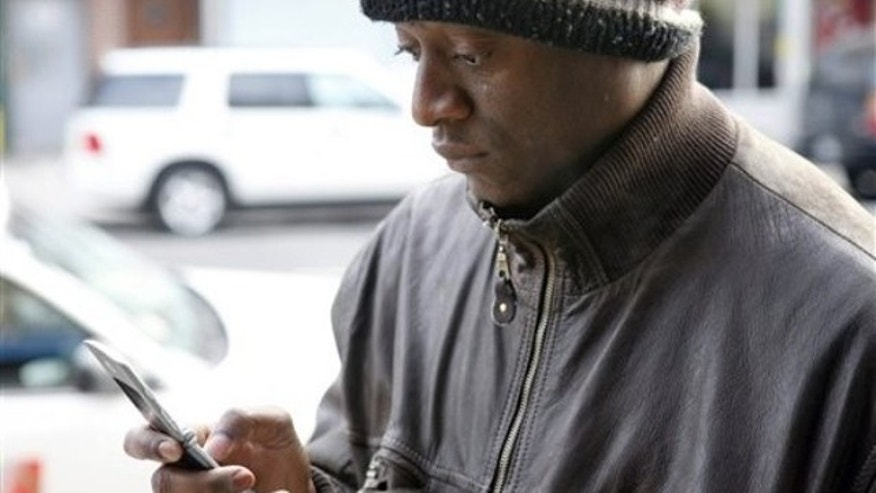 Bernard Toussaint, originally from Port-au-Prince, Haiti, tries to reach his mother in Haiti on his cell phone in New York, Wednesday, Jan. 13, 2010. The International Red Cross says a third of Haiti's 9 million people may need emergency aid and that it would take a day or two for a clear picture of the damage to emerge from Tuesday afternoon's magnitude-7.0 earthquake. (AP Photo/Seth Wenig)