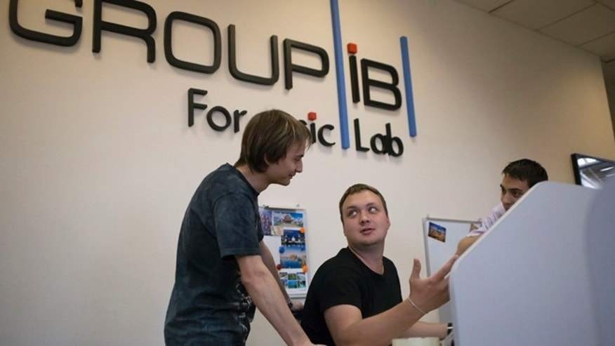May 30, 2013: Employees of Moscows Group-IB, which is responsible for one of Russias two official Internet watchdogs, work in their laboratory in Moscow, Russia. Figures supplied by Group-IB suggest that the number of malicious websites hosted across the Soviet Unions old domain doubled in 2011 and doubled again in 2012, surpassing even the vast number of renegade sites on .ru and its newer Cyrillic-language counterpart.