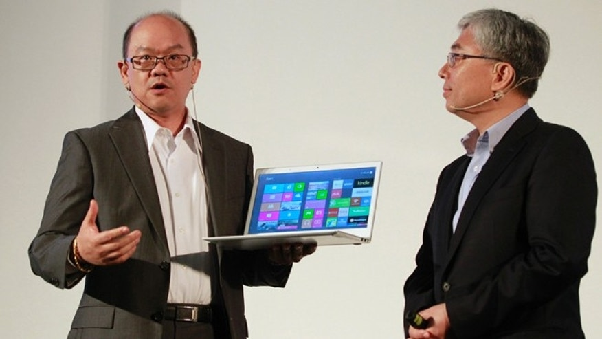 June 3, 2013: Acer&#39&#x3b;s Associated Vice President of Mobile Computing David Lee, left, describes features of the new Aspire S7 Ultrabook to Acer President Jim Wong at an international press conference on the eve of the opening of Computex, one of the world&#39&#x3b;s largest IT exhibitions, in Taipei, Taiwan.