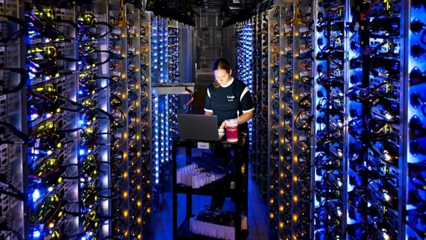 Denise Harwood diagnoses an overheated computer processor at Google's data center in The Dalles, Ore. Google uses such centers to store email, photos, video, calendar entries and other information shared by its users.