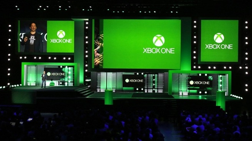 Phil Spencer, corporate vice president of Microsoft Studios, speaks during the Xbox E3 Media Briefing at USC's Galen Center in Los Angeles, California. He later released a statement apologizing for an offensive comment one employee made towards another during a 'Killer instinct' demonstration.