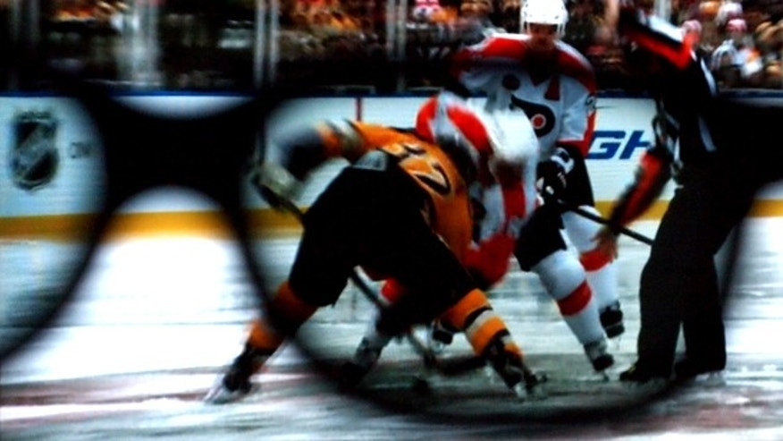 "The view through the 3D lens as the ""Winter Classic"" -- a hockey match from earlier in the year -- is rebroadcast during intermission at Madison Square Garden Wednesday, March 24, 2010."