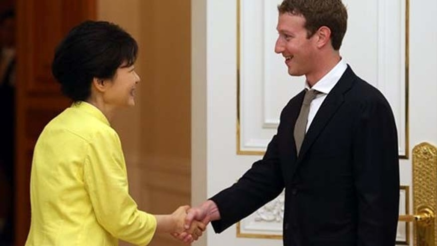 South Korean President Park Geun-hye, left, shakes hands with Facebook CEO Mark Zuckerberg during a meeting at the presidential house in Seoul, South Korea, Tuesday, June 18, 2013.