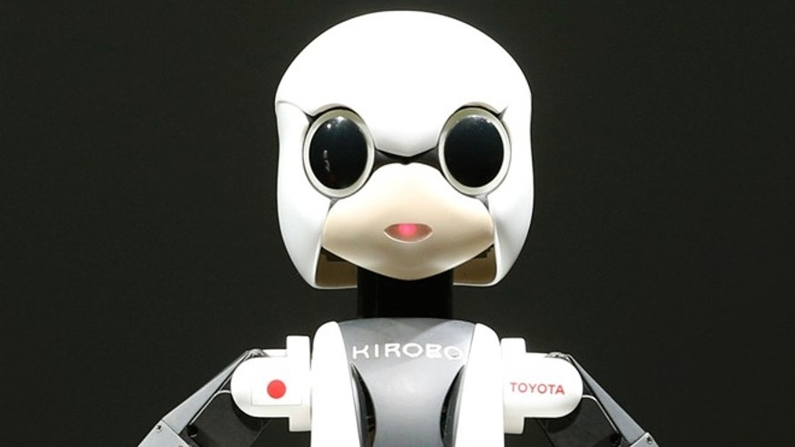 June 26, 2013: Humanoid communication robot Kirobo is shown during a press unveiling in Tokyo. The worlds first space conversation experiment between a robot and humans is ready to be launched.