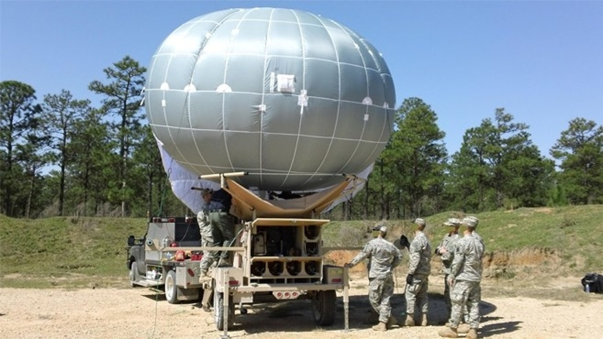 The U.S. military has developed it's own compact gadget, a surveillance blimp that fits in a box that can be loaded onto the back of a truck trailer.